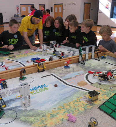 FLL State Tournement Judging with competitors around the table